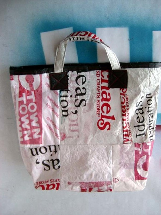Fashion disposable plastic bags into a reusable tote.
