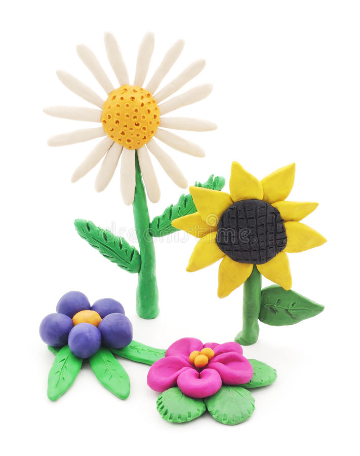 Plasticine flowers. Plasticine flowers on a white background royalty free stock photo