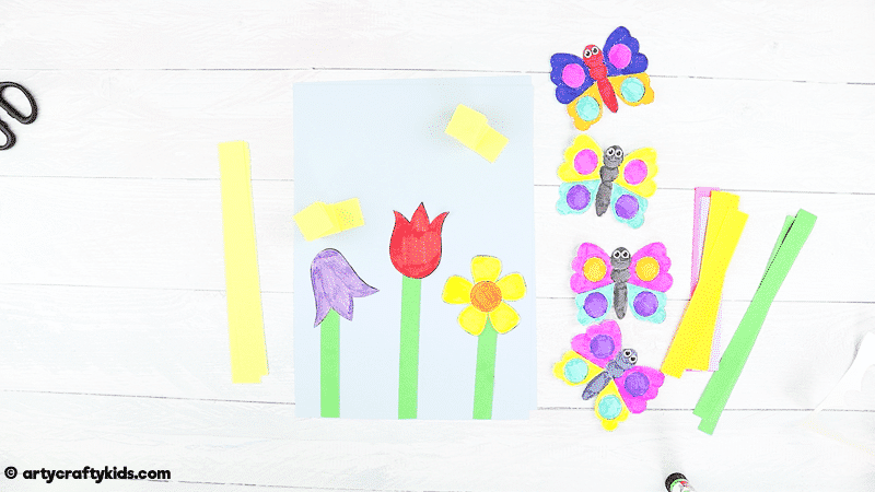 Make a Bobble Butterfly Craft with Spring Flowers with the Kids. A fun and easy Spring craft that kids will love. The butterfly craft can be completed with our printable butterfly template.