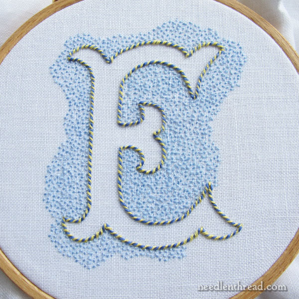 Voided E Monogram in Blue & Yellow